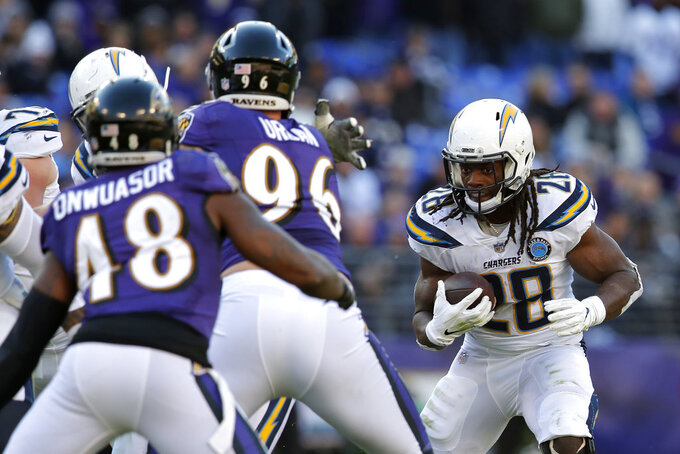 Los Angeles Chargers running back Melvin Gordon (28) rushes the ball in the second half of an NFL wild card playoff football game against the Baltimore Ravens, Sunday, Jan. 6, 2019, in Baltimore. (AP Photo/Carolyn Kaster)