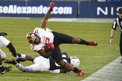 Maryland running back Peny Boone (13) tries to stay in bounds on a second-quarter run against Penn State during an NCAA college football game in State College, Pa., Saturday, Nov. 7, 2020. (AP Photo/Barry Reeger)