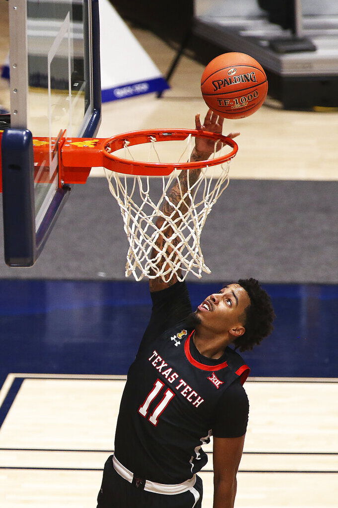 Red Raiders guard Kyler Edwards (11) shoots against West Virginia during the second half of an NCAA college basketball game Monday, Jan. 25, 2021, in Morgantown, W.Va. (AP Photo/Kathleen Batten)