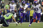 Minnesota Vikings' Stefon Diggs (14) carries past Seattle Seahawks' Mychal Kendricks during the first half of an NFL football game, Monday, Dec. 2, 2019, in Seattle. (AP Photo/John Froschauer)