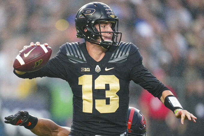 Purdue quarterback Jack Plummer (13) throws against Oregon State during the first half of an NCAA college football game in West Lafayette, Ind., Saturday, Sept. 4, 2021. (AP Photo/Michael Conroy)