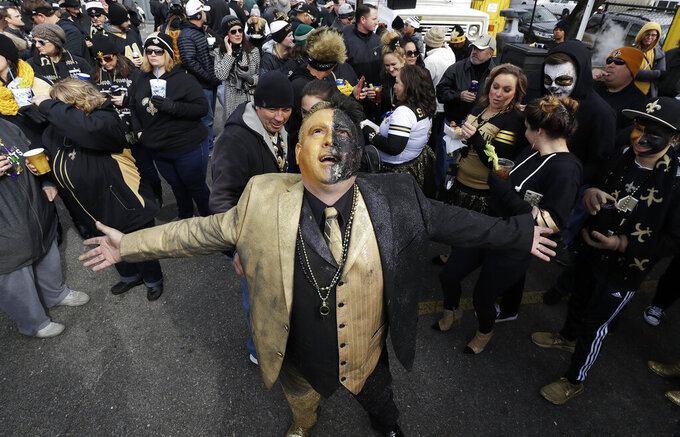 Fans gather outside Mercedes-Benz Superdome before the NFL football NFC championship game between the New Orleans Saints and the Los Angeles Rams Sunday, Jan. 20, 2019, in New Orleans. (AP Photo/David J. Phillip)