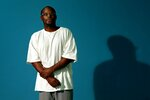 In this Thursday, July 10, 2014 photo, Bobby Bostic stands for a portrait in the visitation room at the Crossroads Correctional Center in Cameron, Mo., where he has served 23 years of a 241-year sentence for a 1995 robbery. At the age of 16, Bostic and a friend held up some people delivering some donated Christmas gifts to a needy St. Louis family. Bostic fired a shot that grazed one man. (Robert Cohen/St. Louis Post-Dispatch via AP)