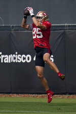 San Francisco 49ers' George Kittle catches a pass during NFL football practice in Santa Clara, Calif., Saturday, Aug. 22, 2020. (AP Photo/Jeff Chiu, Pool)