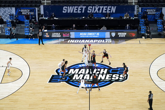 Players get set for the opening tip during the first half of a Sweet 16 game between Loyola Chicago and Oregon State n the NCAA men's college basketball tournament at Bankers Life Fieldhouse, Saturday, March 27, 2021, in Indianapolis. (AP Photo/Darron Cummings)