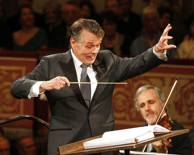 File---Picture taken Jan.1, 2012 shows Latvian conductor Mariss Jansons conducting the Vienna Philharmonic Orchestra during the traditional New Year's Concert at Vienna's Musikverein. Jansons died 76 years old. (AP Photo/Ronald Zak)