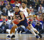 Belmont 's Michael Benkert, left, makes a move to get around Maryland 's Aaron Wiggins during the first half of a first round men's college basketball game in the NCAA Tournament in Jacksonville, Fla. Thursday, March 21, 2019. (AP Photo/Stephen B. Morton)