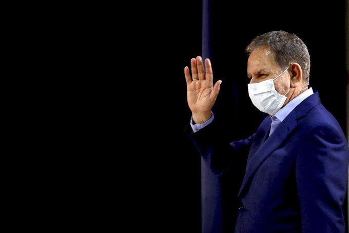 Iranian Vice-President Eshaq Jahangiri attends a news conference after registering his candidacy for the June 18 presidential elections at the elections headquarters of the Interior Ministry in Tehran, Iran, Saturday, May 15, 2021. (AP Photo/Ebrahim Noroozi)