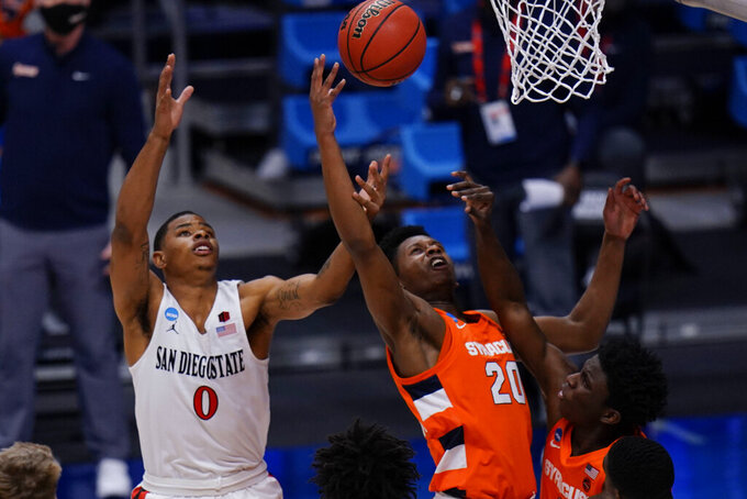 San Diego State forward Keshad Johnson (0) vies for a rebound with Syracuse forward Robert Braswell (20) during the first half of a college basketball game in the first round of the NCAA tournament at Hinkle Fieldhouse in Indianapolis, Friday, March 19, 2021. (AP Photo/AJ Mast)