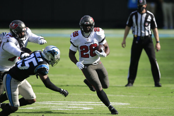 Tampa Bay Buccaneers running back Leonard Fournette (28) runs against the Carolina Panthers during the first half of an NFL football game, Sunday, Nov. 15, 2020, in Charlotte , N.C. (AP Photo/Brian Blanco)
