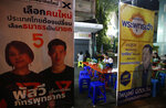 In this Friday, March 15, 2019, photo, election campaign posters surround an outdoor eating area in Bangkok, Thailand. Thailand heads to the polls Sunday, March 24, 2019 to vote in the country's first general election since the military toppled an elected government in a coup nearly five years ago. (AP Photo/Sakchai Lalit)