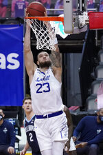 Seton Hall forward Sandro Mamukelashvili dunks during the first half of an NCAA college basketball game against Villanova, Saturday, Jan. 30, 2021, in Newark, N.J. (AP Photo/Mary Altaffer)