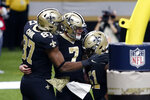 New Orleans Saints quarterback Taysom Hill (7) celebrates his touchdown carry with tight end Jared Cook (87) and center Cesar Ruiz (51) in the second half of an NFL football game in New Orleans, Sunday, Nov. 22, 2020. (AP Photo/Brett Duke)