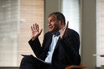 Former Ecuador President Rafael Correa gestures during an interview with Associated Press in Brussels, Thursday, Oct. 10, 2019. Correa is dismissing as