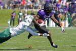 Northwestern wide receiver Malik Washington, right, is tackled by Ohio safety Tariq Drake during the first half of an NCAA college football game in Evanston, Ill., Saturday, Sept. 25, 2021. (AP Photo/Nam Y. Huh)