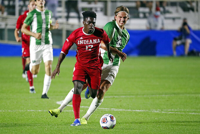 Indiana's Herbert Endeley (17) tries to break away from Marshall's Max Schneider (23) during the first half of the NCAA College Cup championship soccer match in Cary, N.C., Monday, May 17, 2021. (AP Photo/Karl B DeBlaker)