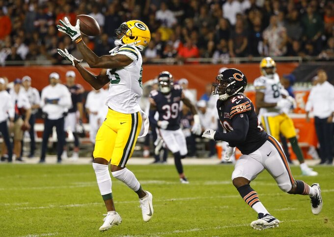 Green Bay Packers' Marquez Valdes-Scantling catches a long pass in front of Chicago Bears' Prince Amukamara during the first half of an NFL football game Thursday, Sept. 5, 2019, in Chicago. (AP Photo/Charles Rex Arbogast)