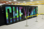 FILE - The Aug. 8, 2017, file photo shows the supercomputer named Cheyenne at the NCAR-Wyoming Supercomputing Center near Cheyenne, Wyo. An arsenal of new technology is being put to the test fighting floods this year as rivers inundate towns and farm fields across the central United States. Drones, supercomputers and sonar that scans deep under water are helping to maintain flood control projects, and predicting just where rivers will roar out of their banks. (AP Photo/Mead Gruver, File)