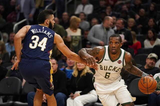 Milwaukee Bucks' Eric Bledsoe drives past New Orleans Pelicans' Kenrich Williams during the second half of an NBA basketball game Wednesday, Dec. 11, 2019, in Milwaukee. (AP Photo/Morry Gash)