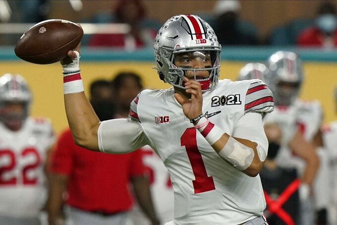 Ohio State quarterback Justin Fields passes against Alabama during the first half of an NCAA College Football Playoff national championship game, Monday, Jan. 11, 2021, in Miami Gardens, Fla. (AP Photo/Lynne Sladky)