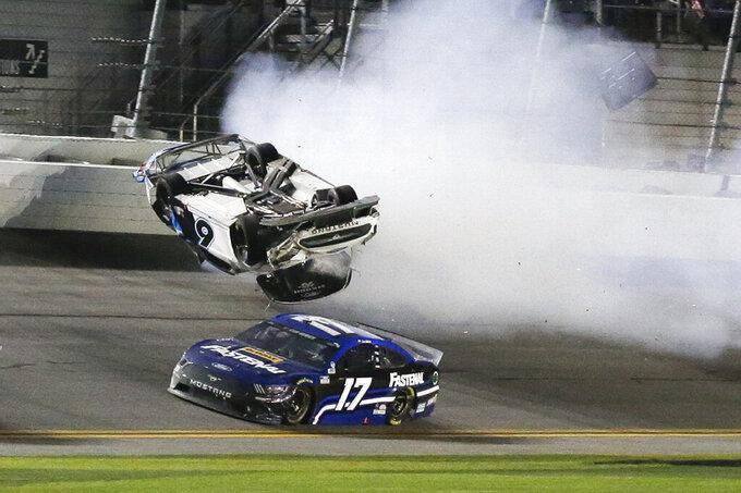 Chris Buescher (17) goes low to avoid Ryan Newman (6) a he wrecks and flips on the final lap of the NASCAR Daytona 500 auto race at Daytona International Speedway, Monday, Feb. 17, 2020, in Daytona Beach, Fla. Sunday's race was postponed because of rain. (AP Photo/Terry Renna)