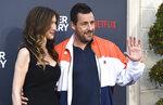 Jackie Sandler and Adam Sandler arrive at the Los Angeles premiere of