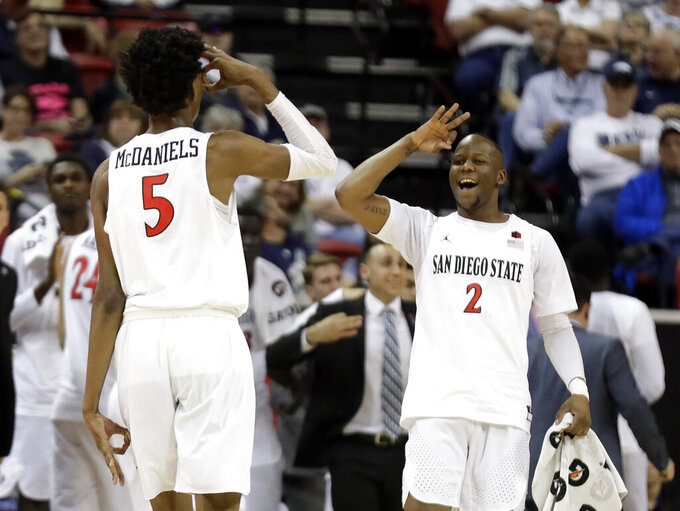 San Diego State's Jalen McDaniels (5) celebrates with teammate Adam Seiko (2) after sinking a 3-point shot during the first half of the team's NCAA college basketball game against UNLV in the Mountain West Conference men's tournament Thursday, March 14, 2019, in Las Vegas. (AP Photo/Isaac Brekken)