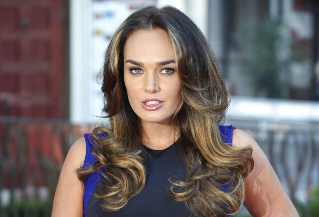 "FILE - In this Monday, Sept. 2, 2013 file photo, Tamara Ecclestone arrives for the World Premiere of the film Rush, at a central London cinema in Leicester Square. London police are investigating the theft of a large cache of ""high value jewelry"" reported stolen from the palatial home of heiress Tamara Ecclestone, the daughter of former Formula 1 chief Bernie Ecclestone. The Sun newspaper said the stolen jewelry was worth about 50 million pounds ($66 million) and included rings, earrings and a Cartier bangle Ecclestone received as a wedding present. (Photo by Joel Ryan/Invision/AP, File)"