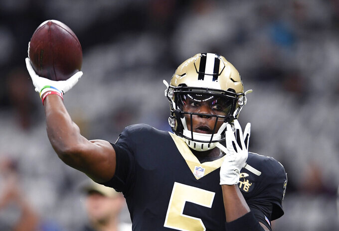 FILE - In this Sunday, Dec. 30, 2018 file photo, New Orleans Saints quarterback Teddy Bridgewater (5) warms up before an NFL football game against the Carolina Panthers in New Orleans. If they get on the field Friday night, Aug. 9, 2019 and most of them are expected to play a handful of former Vikings and current Saints will see some familiar faces on the other side. This will be the first time Bridgewater has played against the Vikings, who drafted him in the first round in 2014 and let him leave as a free agent two years ago after his massive knee injury altered plans to build their offense around him. (AP Photo/Bill Feig, File)