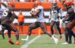 Cleveland Browns running back Nick Chubb runs for a touchdown during an Orange and Brown NFL football practice in Cleveland, Sunday, Aug. 8, 2021. (Joshua Gunter/The Plain Dealer via AP)