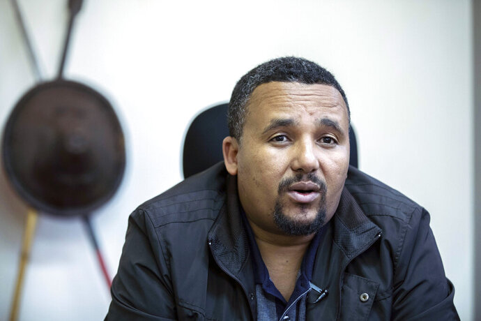 FILE - In this Thursday Oct. 24, 2019 file photo, Jawar Mohammed speaks during an interview with The Associated Press at his house in Addis Ababa, Ethiopia. Ethiopia's most prominent opposition figure, Jawar Mohammed, and 23 other people have been charged with terrorism-related offenses, telecom fraud and other criminal activities, the attorney general's office announced Saturday, Sept. 19, 2020. (AP Photo/Mulugeta Ayene, File)