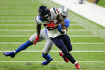 Detroit Lions free safety Will Harris tackles Houston Texans running back Duke Johnson (25) during the first half of an NFL football game, Thursday, Nov. 26, 2020, in Detroit. (AP Photo/Duane Burleson)