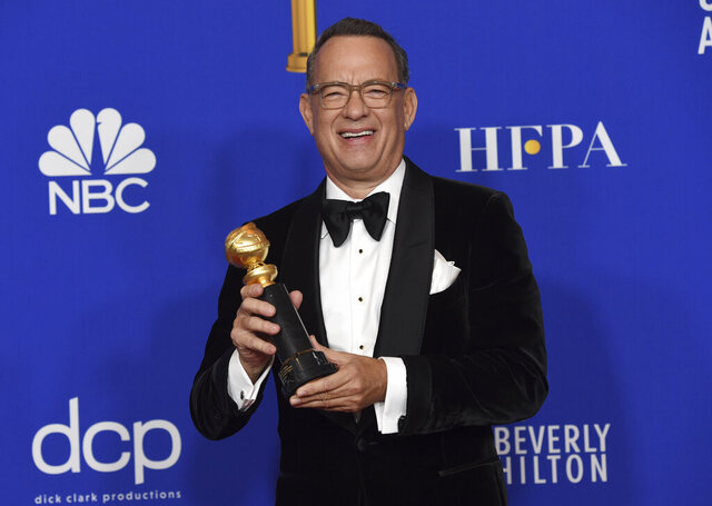Tom Hanks, winner of the Cecil B. deMille Award, poses in the press room at the 77th annual Golden Globe Awards at the Beverly Hilton Hotel on Sunday, Jan. 5, 2020, in Beverly Hills, Calif. (AP Photo/Chris Pizzello)