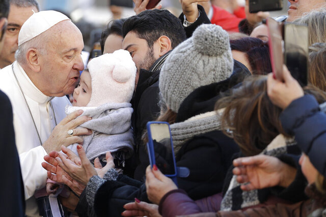 "Pope Francis kisses a a baby as he greets faithful in St. Nicholas Basilica, in Bari, Italy, Sunday, Feb. 23, 2020. The Pope is in Bari to preside the closing of the ""Mediterranean sea a border of peace"" conference. Twenty bishops from the countries overlooking the Mediterranean are attend to talk about peace and dialogue. (AP Photo/Gregorio Borgia)"
