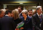 British Prime Minister Theresa May, center, arrives for a round table meeting at an EU summit in Brussels, Thursday, March 21, 2019. British Prime Minister Theresa May is trying to persuade European Union leaders to delay Brexit by up to three months, just eight days before Britain is scheduled to leave the bloc. (AP Photo/Frank Augstein)