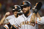 San Francisco Giants' Brandon Belt celebrates with teammates after hitting a grand slam against the Arizona Diamondbacks in the second inning during a baseball game, Saturday, Aug. 17, 2019, in Phoenix. (AP Photo/Rick Scuteri)