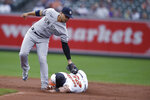 Baltimore Orioles' Anthony Santander is safe on a steal as New York Yankees second baseman Gleyber Torres tries to tag him during the third inning of a baseball game Thursday, Sept. 16, 2021, in Baltimore. (AP Photo/Gail Burton)