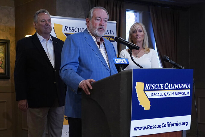 Former Arkansas Gov. Mike Huckabee, a Republican, speaks in support of the recall of Calif., Gov. Gavin Newsom Calif., Friday, July 30, 2021. Huckabee, flanked by former California Secretary of State Bill Jones, a Republican, and Anne Dunsmore, campaign manager of the pro-recall group Rescue California, attended a fund raising breakfast for the recall campaign. While Democratic registration almost doubles that of Republicans in the state, Democratic Party leaders fear Republicans appear more eager to vote in the Sept. 14 election. (AP Photo/Rich Pedroncelli))