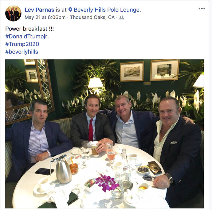 This Facebook screen shot provided by The Campaign Legal Center shows, from left, Donald Trump Jr., Tommy Hicks Jr., Lev Parnas and Igor Fruman, posted on May 21, 2018. Parnas and Fruman were arrested on Thursday, Oct. 10, 2019, on campaign finance violations resulting from a donation to a political action committee supporting President Donald Trump's reelection. (The Campaign Legal Center via AP)