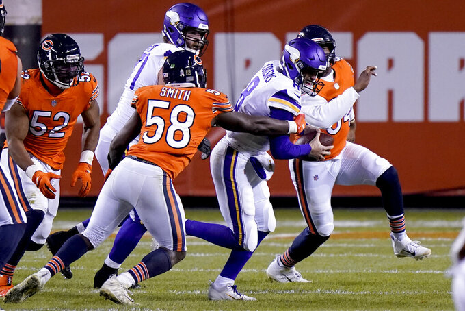 Chicago Bears linebacker Roquan Smith (58) sacks Minnesota Vikings quarterback Kirk Cousins during the second half of an NFL football game Monday, Nov. 16, 2020, in Chicago. (AP Photo/Nam Y. Huh)