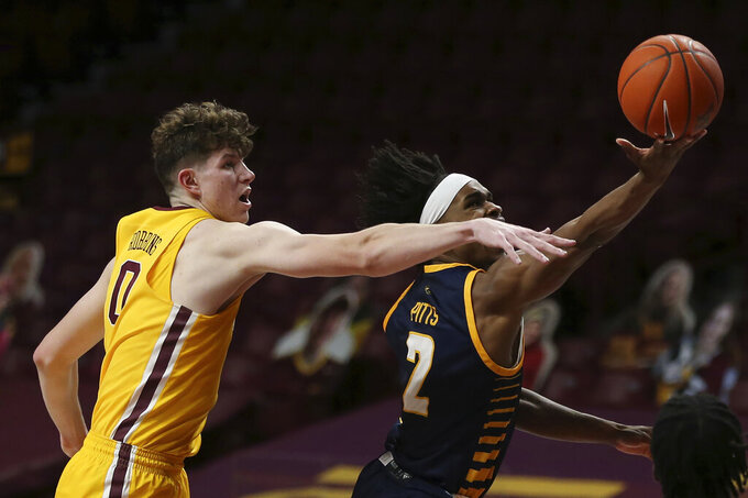 UMKC guard Demarius Pitts (2) tries to shoot the ball against Minnesota center Liam Robbins (0) during an NCAA college basketball game Thursday, Dec. 10, 2020, in Minneapolis.  (AP Photo/Stacy Bengs)