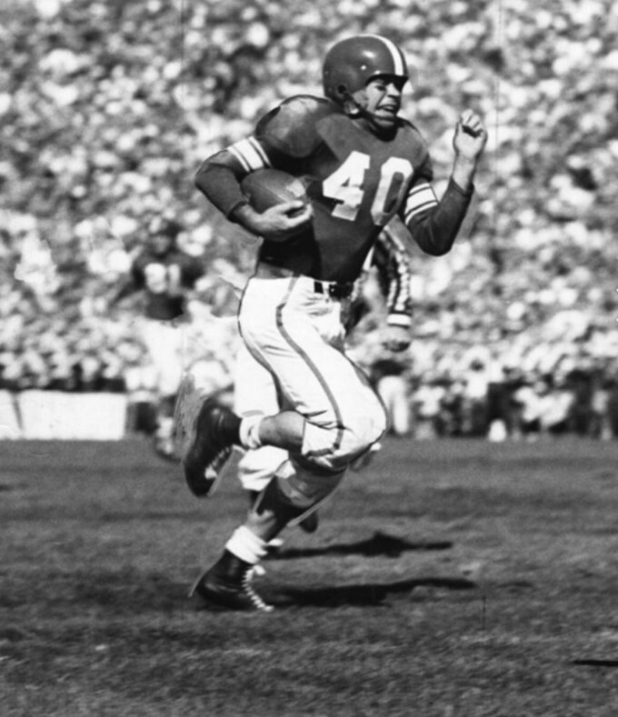 This undated photo provided by Michigan State University shows Don McAuliffe. Former Michigan State football star Don McAuliffe, a fighter in his youth, battled to the very end. The star running back and captain for Michigan State's undefeated 1952 national championship team has died at age 90 on Saturday, July 14, 2018. (Michigan State University via AP)