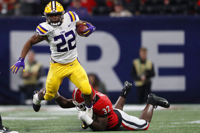 FILE - In this Dec. 7, 2019, file photo, LSU running back Clyde Edwards-Helaire (22) carries during the second half of the Southeastern Conference championship NCAA college football game in Atlanta. Edwards-Helaire was selected by the Kansas City Chiefs with the final pick of the first round of the NFL draft. (AP Photo/John Bazemore, File)