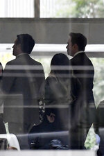 Tesla CEO Elon Musk, right, arrives at federal court, Tuesday, Dec. 3, 2019, in Los Angeles. Musk is going on trial for his troublesome tweets in a case pitting the billionaire against a British diver he allegedly dubbed a pedophile. (AP Photo/Mark J. Terrill)