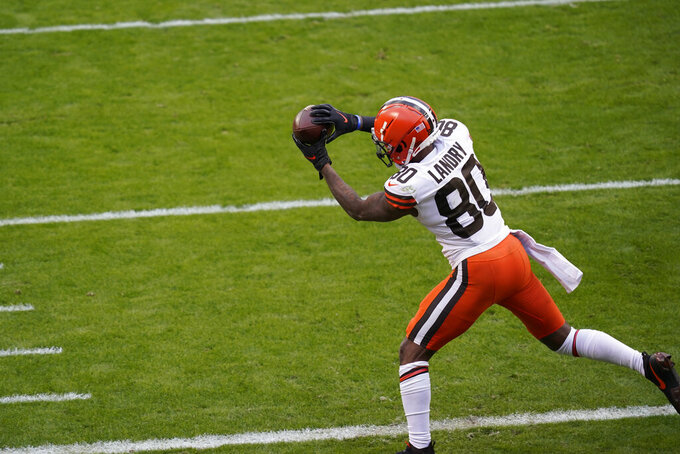 Cleveland Browns wide receiver Jarvis Landry catches a 4-yard touchdown pass during the second half of an NFL divisional round football game against the Kansas City Chiefs, Sunday, Jan. 17, 2021, in Kansas City. (AP Photo/Orlin Wagner)