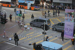 Police cordons off the scene of a morning shooting in Hong Kong Monday, Nov. 11, 2019. Police in Hong Kong shot a protester as demonstrators blocked subway lines and roads during the Monday morning commute. (AP Photo/Kin Cheung)
