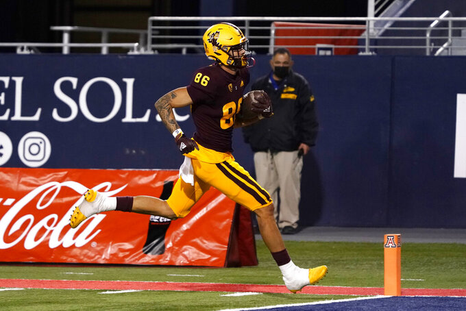 Arizona State tight end Curtis Hodges (86) scores a touchdown against Arizona in the second half during an NCAA college football game, Friday, Dec. 11, 2020, in Tucson, Ariz. (AP Photo/Rick Scuteri)