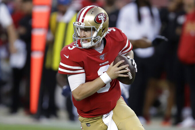 San Francisco 49ers quarterback C.J. Beathard rolls out to pass against the Los Angeles Chargers during the first half of an NFL preseason football game in Santa Clara, Calif., Thursday, Aug. 29, 2019. (AP Photo/Ben Margot)