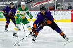 Arizona Coyotes center Nick Schmaltz (8) skates away from Minnesota Wild left wing Kirill Kaprizov (97) in the second period during an NHL hockey game, Saturday, March 6, 2021, in Glendale, Ariz. (AP Photo/Rick Scuteri)