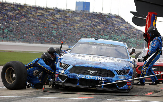 Kevin Harvick pits during the NASCAR Cup Series auto race at Kansas Speedway in Kansas City, Kan., Saturday, May 11, 2019. (AP Photo/Colin E. Braley)